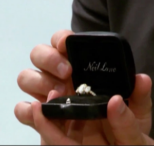 Garrette holding the engagement ring